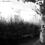 A couple in Cohasset, MA is caught walking by two photographers. Image by Katherine Deakin