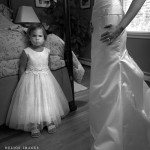 The flower girl waits for the bride.