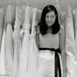 Ploy poses amidst a sea of Vera Wang designer dresses in their home at Vera Wang Boston on famed Newbury Street.