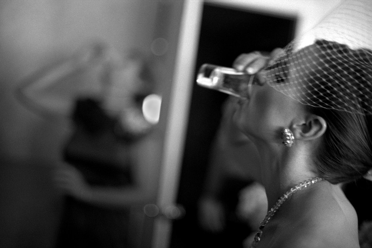 bride taking shot of liquor before ceremony.