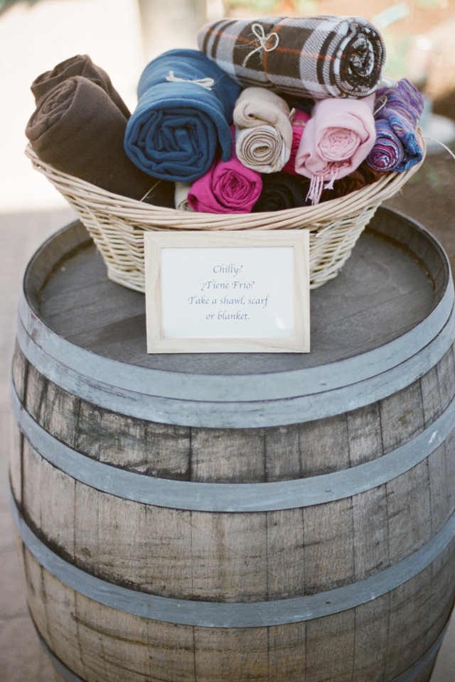 little blankets in a barrel at a wedding