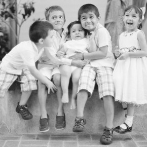 five kids pose for a picture