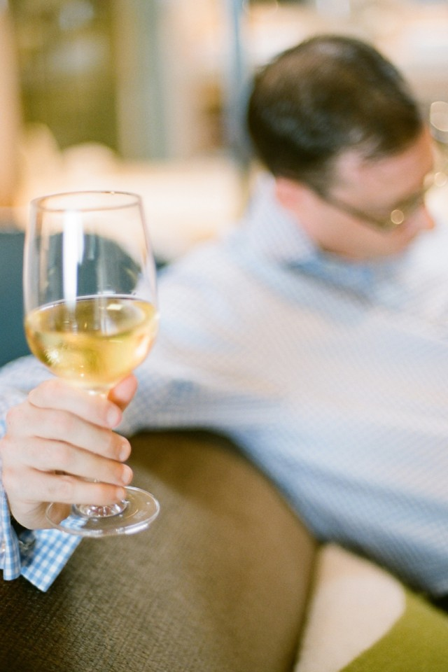 groom sipping white wine