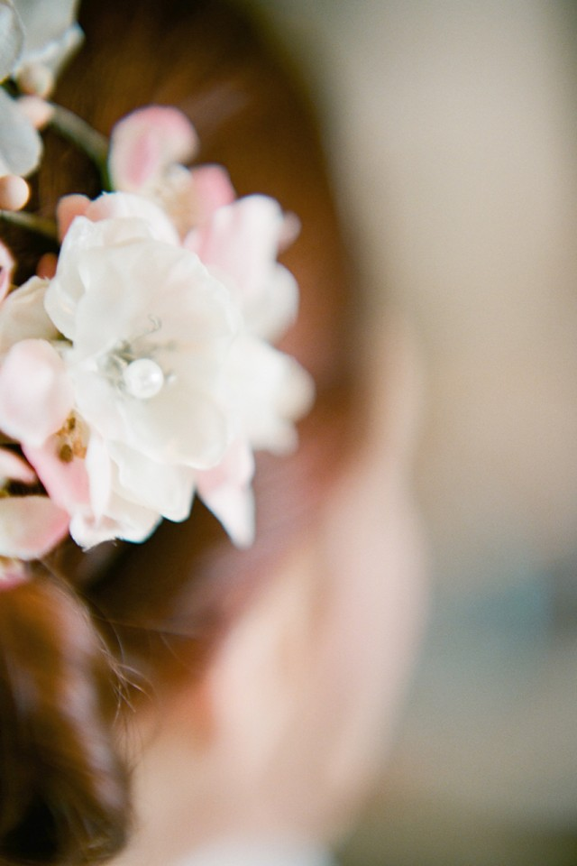 flowers in red hair for wedding bride